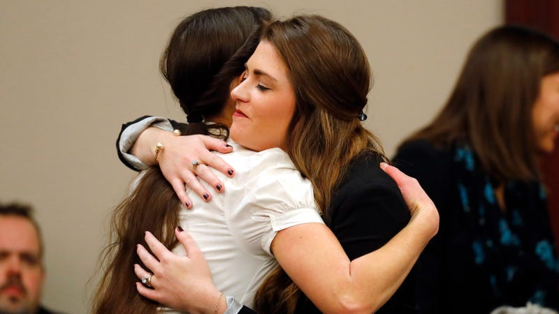 Rachael Denhollander, left, hugs Sterling Riethman after Larry Nassar's plea hearing in Lansing, Mich in Nov. 2017