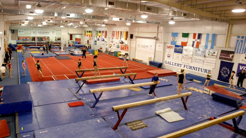 Gymnast workout with their personal coaches during a morning workout session at Karolyi Ranch in Texas in 2011.