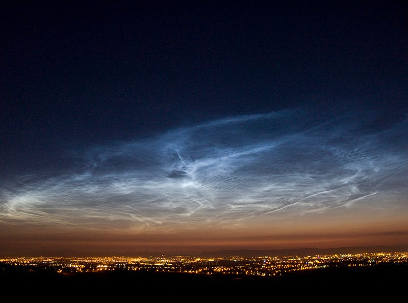 """Illustration for article titled Glowing """"Meteor Smoke"""" Clouds Appear Over Antarctica"""