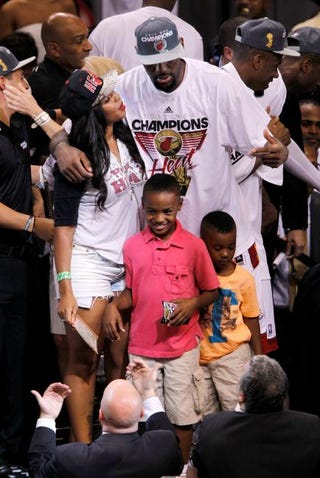 LeBron James (center) celebrates with his wife and sons June 21, 2012, after the Miami Heat beat the Oklahoma City Thunder in Game 5 of the 2012 NBA Finals at American Airlines Arena in Miami.Mike Ehrmann/Getty Images