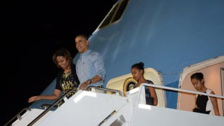 President Barack Obama, frst lady Michelle Obama and their daughters Sasha and Malia disembark Air Force One at Joint Base Pearl Harbor-Hickam in Honolulu, Hawaii.JEWEL SAMAD/AFP/Getty Images