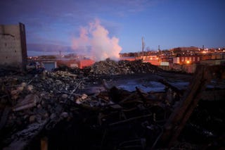 The remains of a senior center set ablaze during unrest in Baltimore smolder at dawn April 28, 2015. The unrest came hours after the funeral April 27, 2015, for Freddie Gray, the unarmed 25-year-old man who died while in police custody.Mark Makela/Getty Images
