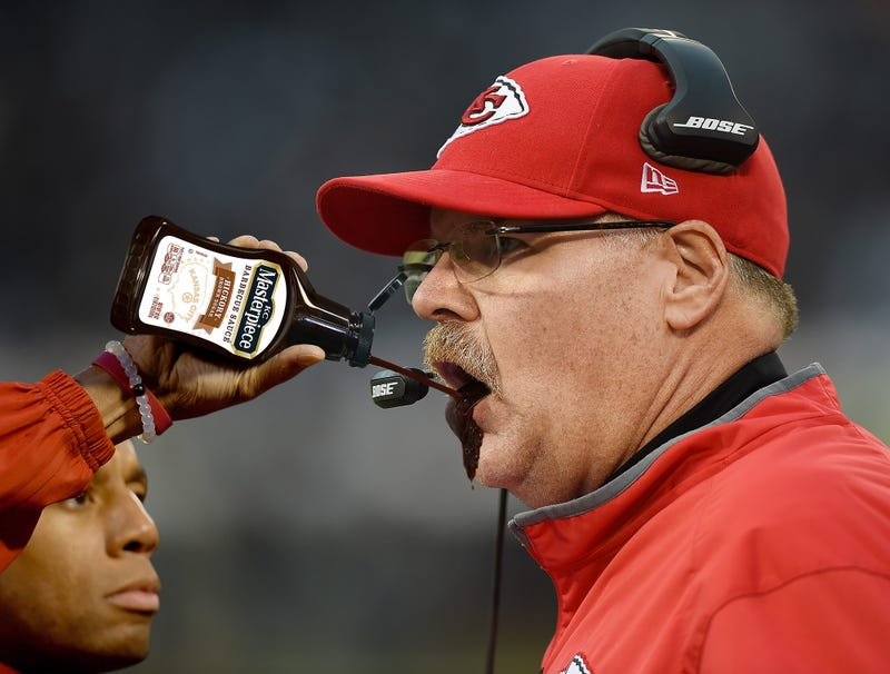 Illustration for article titled Chiefs Trainer Squirts Bottle Of KC Masterpiece Into Andy Reid's Mouth