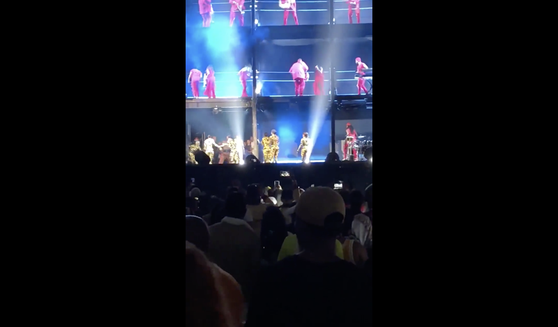 Chaos on the stage after a fan runs on to chase Beyoncé and Jay-Z