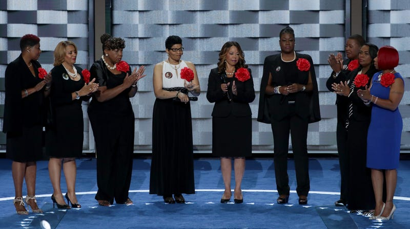 Mothers of the Movement (L-R) Maria Hamilton, mother of Dontre Hamilton; Annette Nance-Holt, mother of Blair Holt; Gwen Carr, mother of Eric Garner; Geneva Reed-Veal, mother of Sandra Bland; Lucia McBath, mother of Jordan Davis; Sybrina Fulton, mother of Trayvon Martin; Cleopatra Pendleton-Cowley, mother of Hadiya Pendleton; Wanda Johnson, mother of Oscar Grant; and Lezley McSpadden, Mother of Mike Brown stand on stage prior to delivering remarks on the second day of the Democratic National Convention, July 26, 2016 in Philadelphia, Pennsylvania.