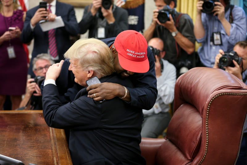 Kanye West hugs U.S. President Donald Trump during a meeting in the Oval office of the White House on Oct. 11, 2018 in Washington, DC.