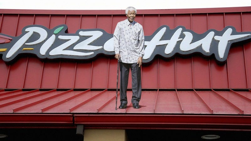 Nelson Mandela on top of a Pizza Hut.