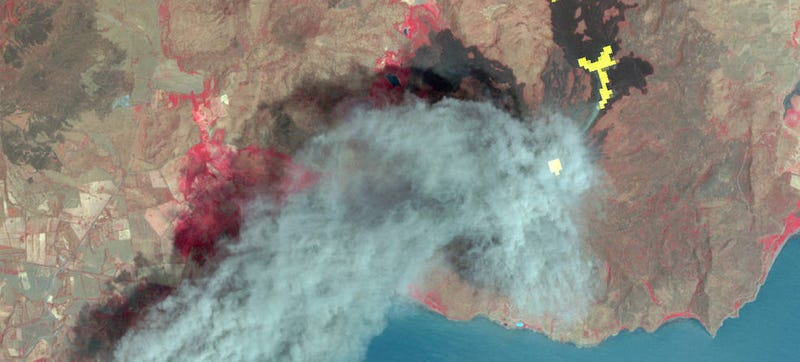 Image of Nicaragua's Momotombo volcano from the ASTER device. Hot lava flows are shown in yellow. Image by NASA/GSFC/METI/ERSDAC/JAROS, and U.S./Japan ASTER Science Team