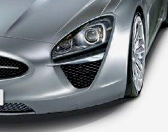 Illustration for article titled 2013 Jaguar XE: Biggest. Cat's Eyes. Ever.