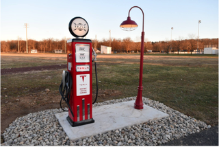 Illustration for article titled retro looking Tesla charging station