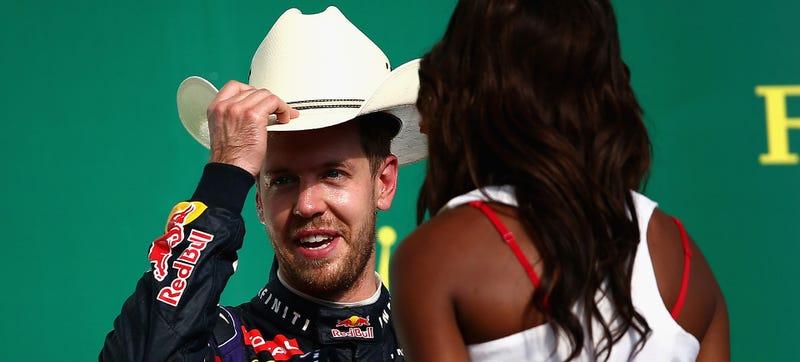 German F1 quadruple-champion Sebastian Vettel tries on a cowboy hat after winning the 2013 U.S. Grand Prix in Austin, Texas. Photo: Getty