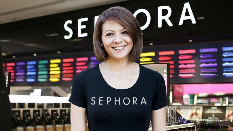 A woman in a Sephora uniform at a Sephora.