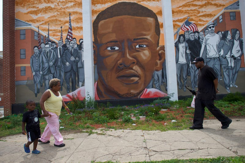 People walk past a mural of Freddie Gray in Baltimore on June 23, 2016, after Baltimore Police Officer Caesar Goodson Jr. was found not guilty on all charges regarding Gray's death  while in police custody.Mark Makela/Getty Images