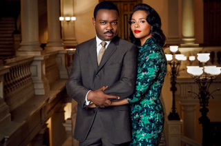 Martin Luther King Jr. (played by David Oyelowo) and Coretta Scott King (played by Carmen Ejogo) in the courthouse in a scene from the film Selma. Costume designer Ruth Carter wanted to portray them as a striking couple who cared deeply about civil rights but who also have come to symbolize the black glamour of the era. Gasper Tringale