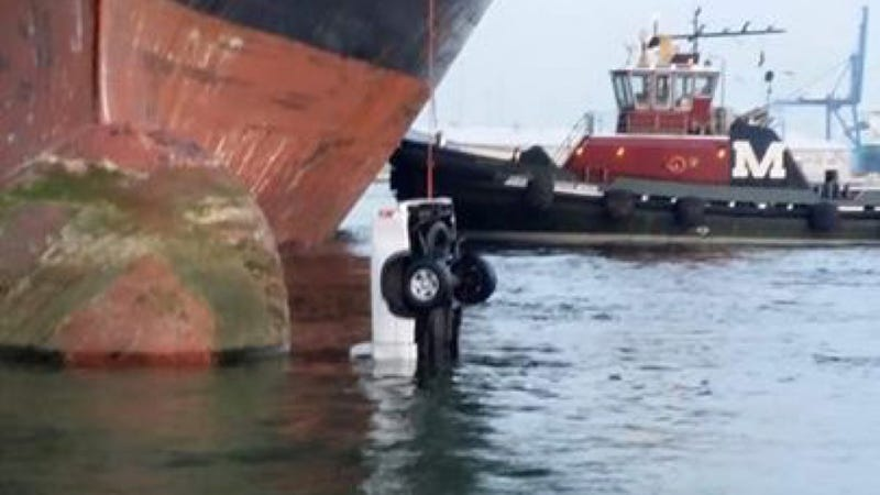 Illustration for article titled Cargo Fail Leaves Truck Dangling Off A Ship Like Bait On A Fishing Line