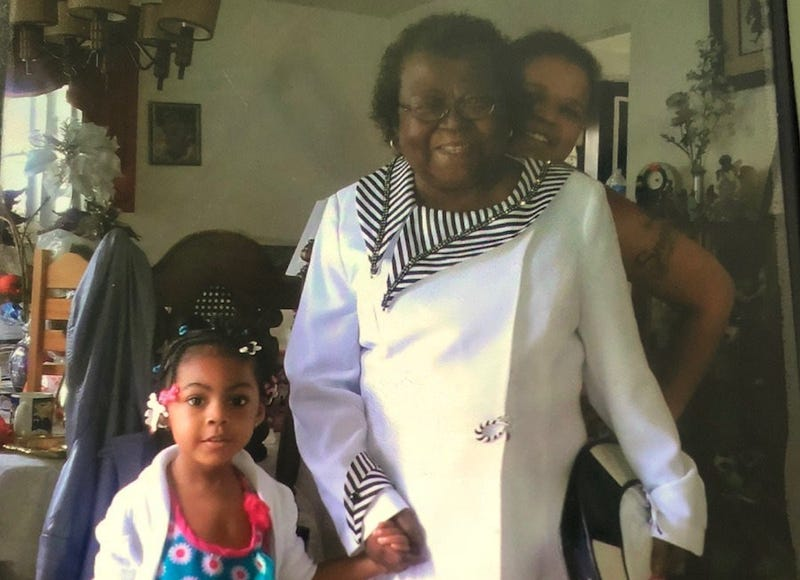 Linda Daniels poses with two of her granddaughters.