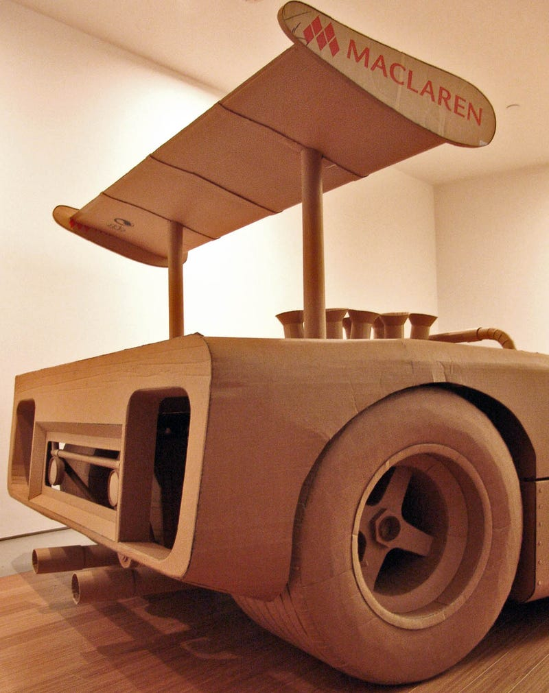 Illustration for article titled Artist Builds Amazing Vintage Racer From Cardboard And Hot Glue