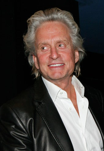 Illustration for article titled Michael Douglas Will Play Liberace; Angelina Takes Zahara Back To Ethiopia