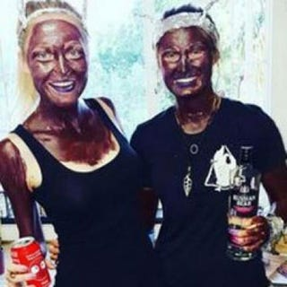 The initial photo of the two Stellenbosch University students that caused outrage when it appeared that they were wearing black or brown paint Twitter