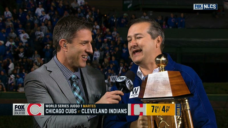 Cubs owner Tom Ricketts with Kevin Burkhardt of FOX.