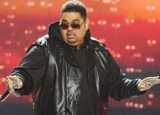 Illustration for article titled Heavy D's Family: His 'Bear Hugs' Will Be Missed