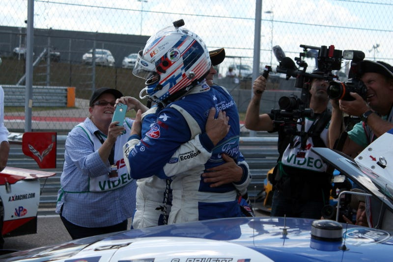 Illustration for article titled Scott Pruett Gets 60th Win In Sportscars, Hugs From Teammate Joey Hand
