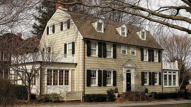 The real-life Amityville house in 2005, still recognizable even without those eye-shaped windows.