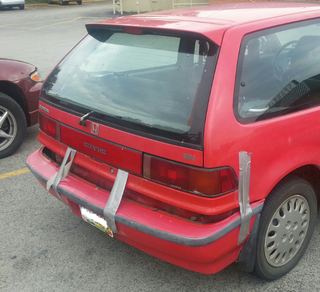 Illustration for article titled Honda Civic Bumper Hangs On For Dear Life