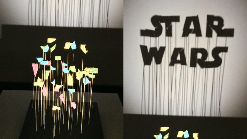 "Why yes, that is a Star Wars logo made from pieces of perfectly coordinated trash on sticks in  artist ""Red"" Hong Yi's work."