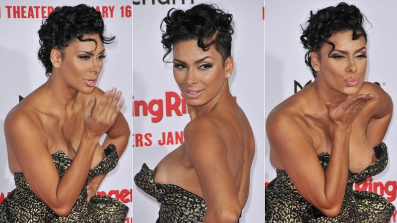 rogue boob makes surprise appearance on wedding ringer red carpet