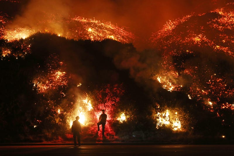 Firefighters monitor a section of the Thomas Fire along the 101 freeway this morning. (Photo: Mario Tama/Getty Images.)