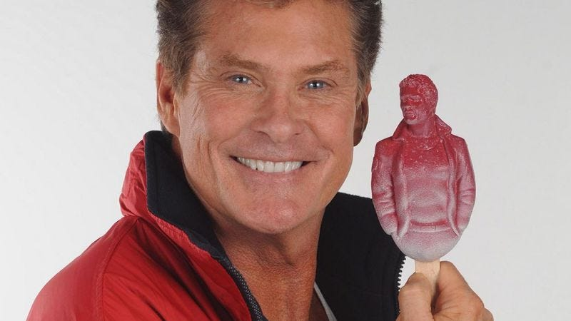 This is a picture of David Hasselhoff holding a popsicle version of himself.