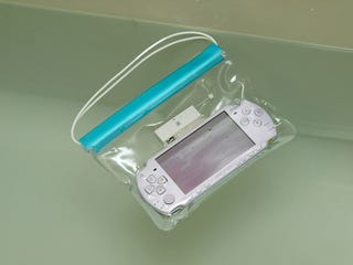 Illustration for article titled Waterproof PSP Bath Bag Is Every 9-Year-Old's Wet Dream