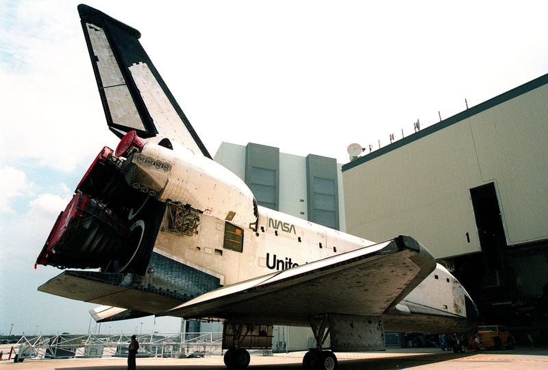The Space Shuttle orbiter Columbia sits outside the Orbiter Processing Facility bay 1 on April 15, 1999 (Photo by NASA)