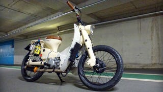 Illustration for article titled Every Honda Cub Should Have A 15-Shot Of NOS