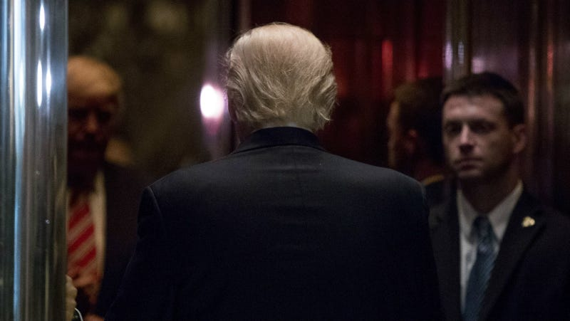 Trump boarding an elevator at Trump Tower. Reports indicate the he frequently doesn't get further outside than the lobby. Photo via AP