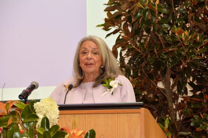 Dr. Vivian W. Pinn, senior scientist emerita at the National Institutes of Health, speaks at the dedication ceremony of a building renamed Pinn Hall in her honor at the University of Virginia School of Medicine in Charlottesville, Va. (Welford Jones)