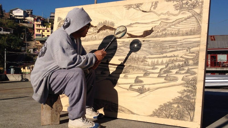 Illustration for article titled This Artist Uses His Magnifying Glass To Burn Pictures, Not Ants