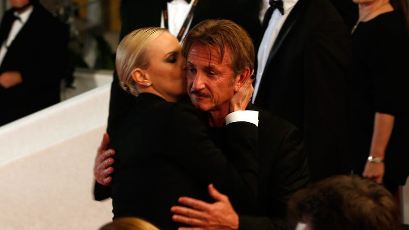 Illustration for article titled Charlize Theron Kisses Journalist Sean Penn