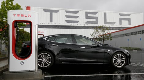 Tesla Contract Workers Pressured To Accept Debit Card For