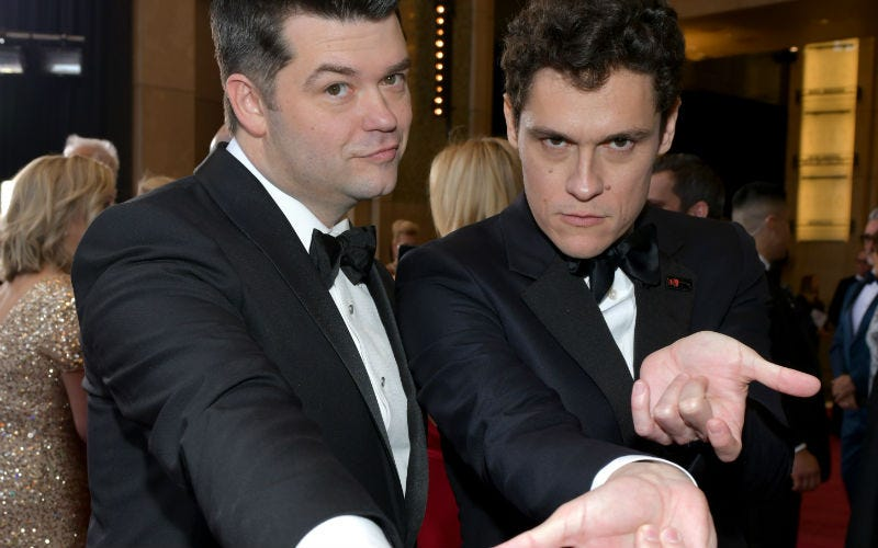 Chris Miller and Phil Lord do their best Spider-Man pose at this year's Oscars.