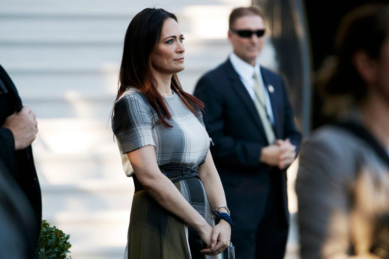 In this June 21, 2019 photo, Stephanie Grisham, spokeswoman for first lady Melania Trump, watches as President Donald Trump and the first lady greet attendees during the annual Congressional Picnic on the South Lawn in Washington.