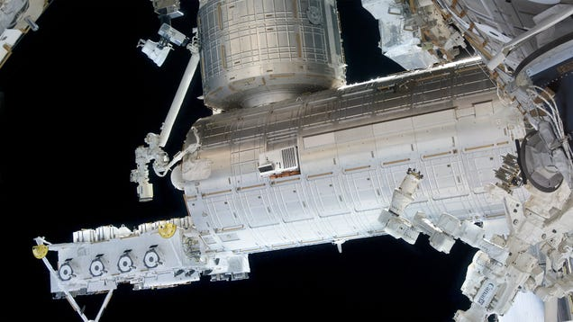 AC Unit Propped Up By Bricks Dangling Precipitously From ISS Window