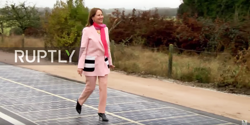 French Ecology Minister Ségolène Royal walks on the new solar road.