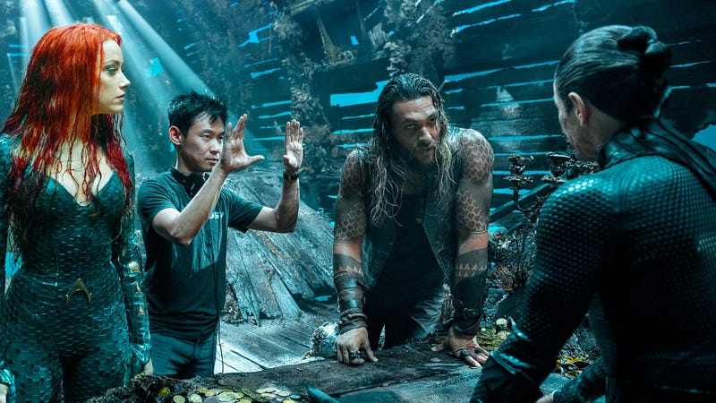 From left to right: Amber Heard as Mera, director James Wan, Jason Momoa as Aquaman, and Willem Dafoe as Vulko.