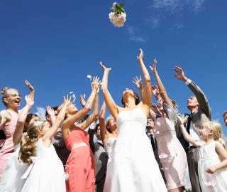 Illustration for article titled Eternal Bridesmaid Seeks World Record for Catching Bouquets