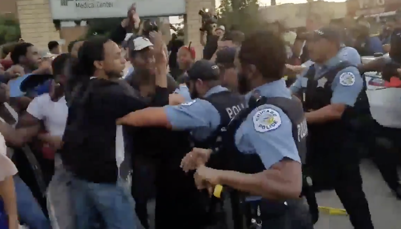 Confrontation between protesters and Chicago police, July 14, 2018.
