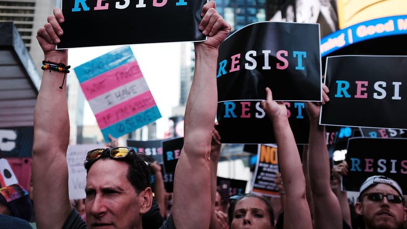 A group of protestors gathered in protest to Trumps proposed transgender military ban. Image: Getty