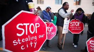 Protesters, mostly union and retired city workers, demonstrate in front of the federal courthouse where Detroit's bankruptcy eligibility trial began on Oct. 23, 2013, in Detroit.Bill Pugliano/Getty Images
