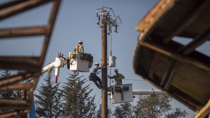 File photo of PG&E restoring power after fires in October 2017